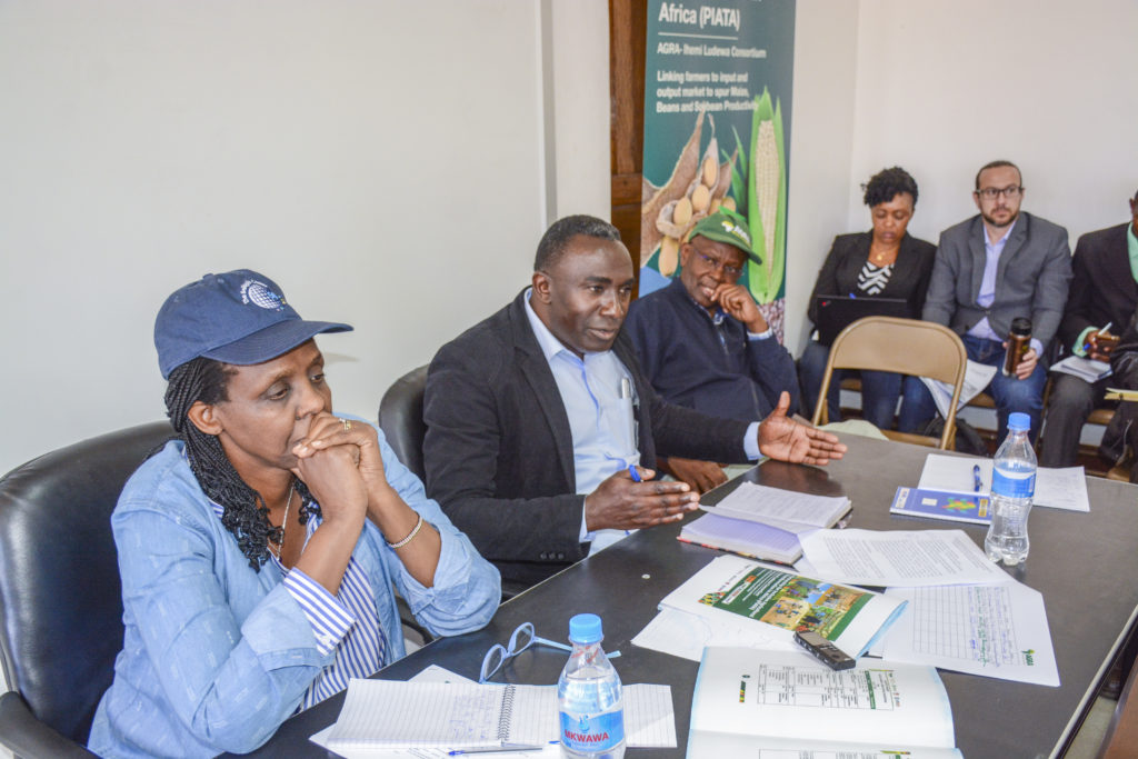 Mr. Wilfred Myuyu (in the middle), Iringa Region Acting Regional Administrative Secretary (RAS) addresses a workshop for sharing experiences about the green revolution in his area.  On his right is AGRA President Dr. Agnes Kalibata and on his left, is  Prof. Nuhu Hatibu, AGRA Regional Head for EAC.